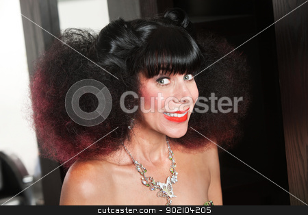 White Lady in Afro and Big Smile stock photo, Excited Caucasian woman with afro haircut and big grin by Scott Griessel