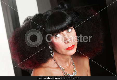 Serious Woman with Frizzy Hair stock photo, Middle aged woman with afro haircut looking over by Scott Griessel