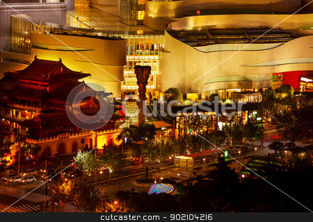 Jing An Temple Park Nanjing Street Shanghai China stock photo, Golden Temples Roof Top Jing An Tranquility Temple Park at Nanjing Street Cars and Intersection in Central Shanghai, China. Richest buddhist temple in Shanghai.  Trademarks removed or obscured. by William Perry