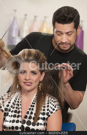 Embarrassed Woman with Hairdresser stock photo, Attractive female with hair problem and embarrassed hair stylist by Scott Griessel