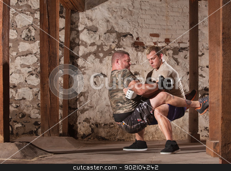 Fighters Doing Guard Situps stock photo, Mixed martial artists practicing guard sit ups by Scott Griessel