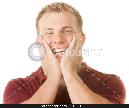 Happy Man With Hands on Face stock photo, Smiling young man with hands on face over white by Scott Griessel