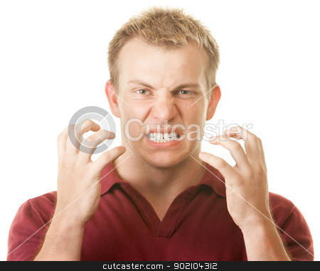 Angry Man Clenching Teeth stock photo, Angry blond muscular Caucasian man with clenched teeth by Scott Griessel
