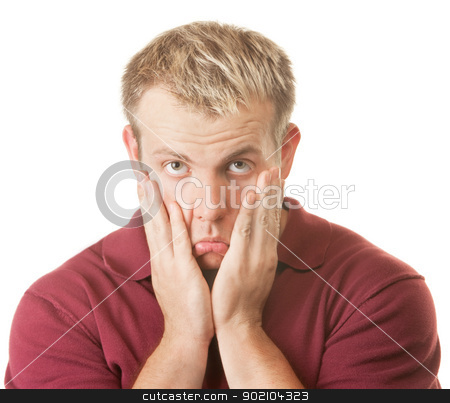 Sad Man Pulling on Face stock photo, Sad man pulling on face over white background by Scott Griessel