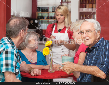 Happy Senior with Friends in Cafe stock photo, Senior Caucasian male sitting with friends in a cafe by Scott Griessel