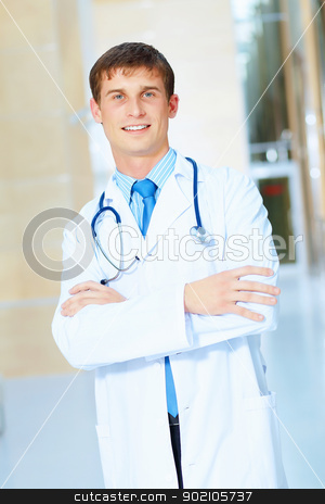 friendly male doctor stock photo, Portrait of friendly male doctor in hospital smiling by Sergey Nivens