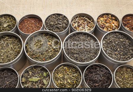 loose leaf tea background stock photo, samples of loose leaf green, white, black red, and herbal tea in metal cans on canvas background by Marek Uliasz