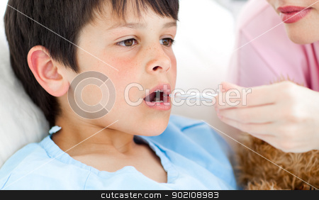 Serious nurse taking child&#039;s temperature  stock photo, Serious nurse taking child&#039;s temperature in a hospital by Wavebreak Media
