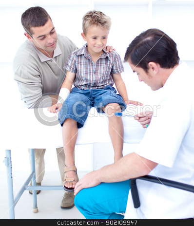 Doctor checking a patient reflexes stock photo, Doctor checking a little patient reflexes by Wavebreak Media