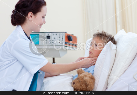 Female doctor examining child throat stock photo, Female doctor examining child throat in bed by Wavebreak Media
