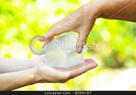 house  stock photo, The house in human hand by Vitaliy Pakhnyushchyy