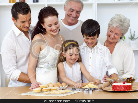 Parents and granparents looking at children baking stock photo, Parents and granparents looking at children baking in the kitchen by Wavebreak Media