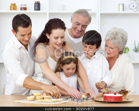 Parents, grandparents and children baking in the kitchen stock photo, Happy parents, grandparents and children baking in the kitchen by Wavebreak Media