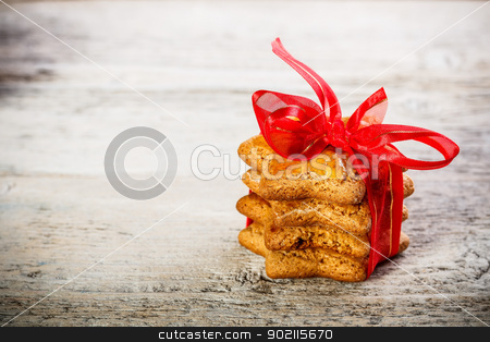Gingerbread cookies stock photo, Christmas gingerbread cookies tied with red ribbon by Grafvision