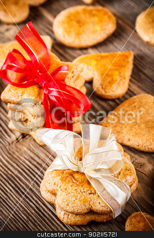 Handmade gingerbread cookies stock photo, Handmade gingerbread cookies on wooden table by Grafvision