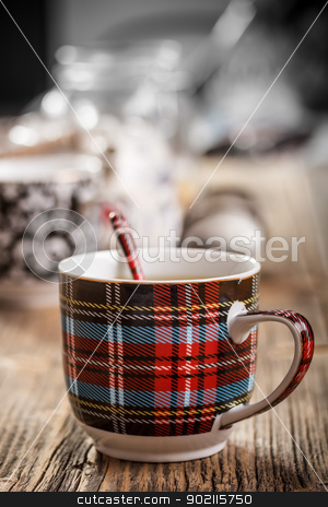 Cup of tea and spoon stock photo, Cup of tea and spoon on wooden background by Grafvision