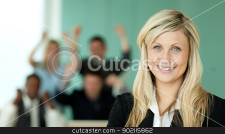 Businesswoman and the team in an office stock photo, Businesswoman and her team in an office with a green background by Wavebreak Media