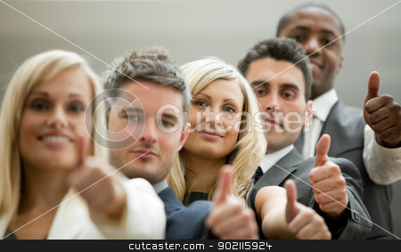 Business team with the thumbs up stock photo, Business team with the thumbs up in a stairs by Wavebreak Media