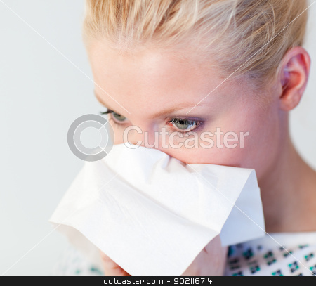 Patient with the flu stock photo, Young Patient with the flu in a hospital by Wavebreak Media