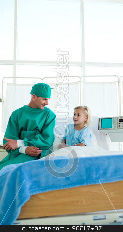 Surgeon discussing a patient case history stock photo, Surgeon discussing a patient case history in a hospital by Wavebreak Media
