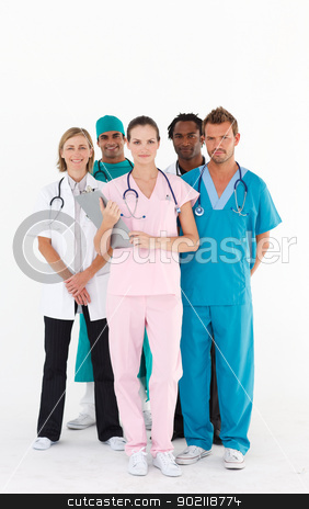 Confident team of doctors looking at the camera stock photo, Confident international team of doctors looking at the camera by Wavebreak Media