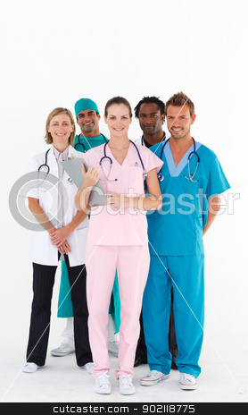 Team of doctors smiling at the camera stock photo, Standing team of doctors smiling at the camera by Wavebreak Media