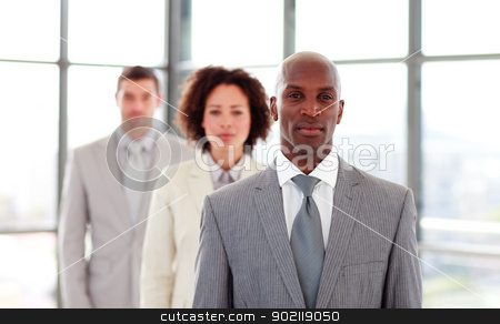 Serious African-American businessman leading his colleagues stock photo, Serious African-American businessman leading his colleagues in office by Wavebreak Media