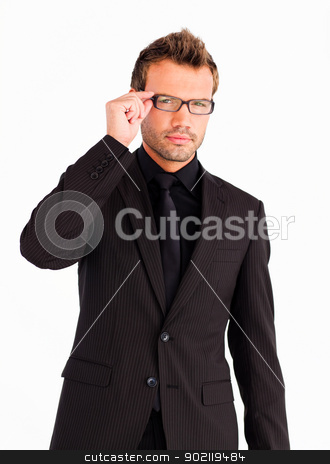 Young businessman with glasses looking at the camera  stock photo, Young businessman with glasses looking seriously at the camera  by Wavebreak Media