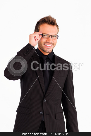 Handsome businessman with glasses looking at the camera  stock photo, Handsome businessman with glasses smiling at the camera  by Wavebreak Media