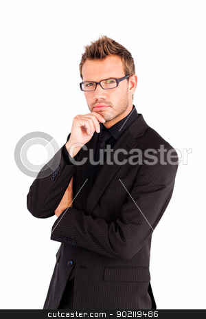 Confident businessman with glasses looking at the camera  stock photo, Confident businessman with glasses looking at the camera  by Wavebreak Media