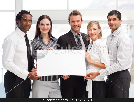 Business team holding a blank card stock photo, Business team holding a blank card in front of the camera by Wavebreak Media
