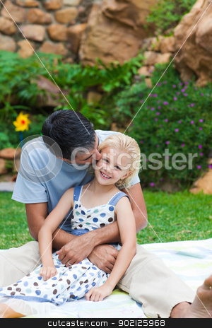 Father kissing his daughter in a park stock photo, Father kissing his little daughter in a park with copy-space by Wavebreak Media