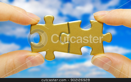 puzzle  stock photo,  puzzle in hand isolated on sky background by Vitaliy Pakhnyushchyy