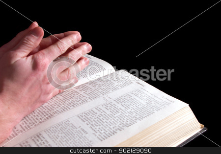 hands stock photo, A mans hands clasped in prayer over a  Bible by Vitaliy Pakhnyushchyy
