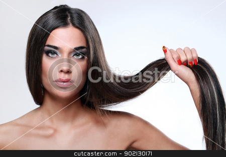 Attractive woman with beautiful long glossy hair stock photo, Close up of attractive woman with beautiful long glossy hair by yekostock