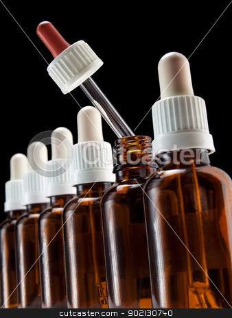 Alternative therapy stock photo, Different color of one of droppers in a row can suggest an alternative choice in a medical therapy. by Sinisa Botas