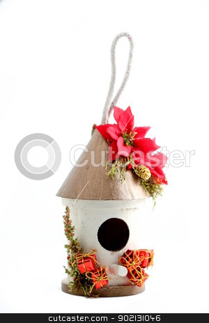 Christmas Bird House stock photo, Christmas bird hose on white background. by Henrik Lehnerer