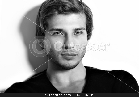 Portrait of handsome and attractive man stock photo, Portrait of handsome and attractive man in studio by yekostock