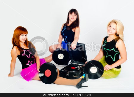 Three pretty girls with gramophone stock photo, Young beautiful women sitting near gramophone at white background by Aikon