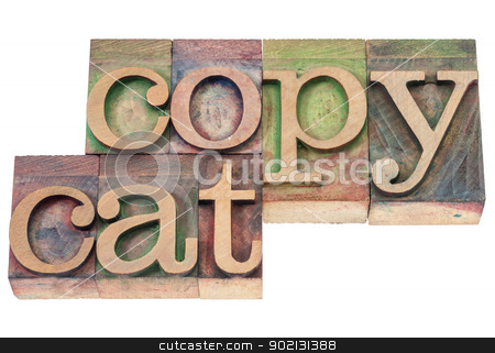 copycat word in wood type stock photo, copycat  - isolated text in vintage letterpress wood type blocks stained by color inks by Marek Uliasz