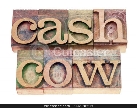 cash cow in wood type stock photo, cash cow - isolated text in vintage letterpress wood type blocks stained by color inks by Marek Uliasz