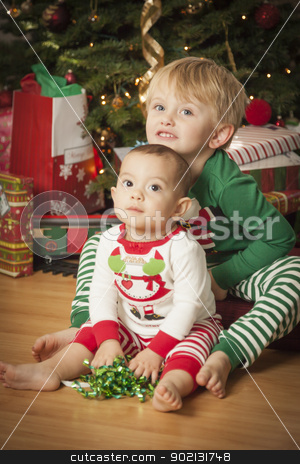 Mixed Race Baby and Young Boy Enjoying Christmas Morning Near Th stock photo, Cute Infant Mixed Race Baby and Young Boy Enjoying Christmas Morning Near The Tree. by Andy Dean