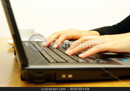laptop stock photo,  hands fast typing on laptop by Vitaliy Pakhnyushchyy
