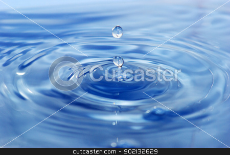 drops stock photo, The round transparent drop of water falls downward by Vitaliy Pakhnyushchyy