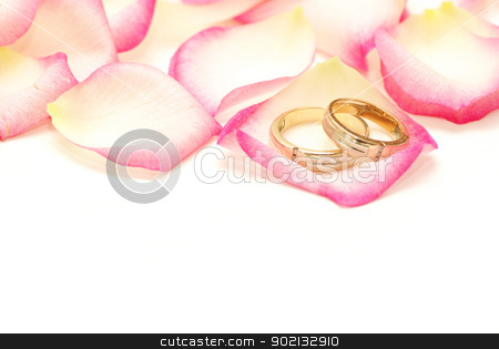 Wedding rings  stock photo, Wedding rings on a red rose petal by Vitaliy Pakhnyushchyy