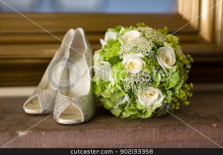 wedding shoes and flowers bouquet stock photo, wedding shoes and wedding bouquet of white roses by Lee Avison
