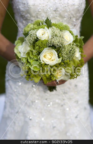bride holding a wedding bouquet stock photo, bride holding a wedding bouquet of white roses by Lee Avison