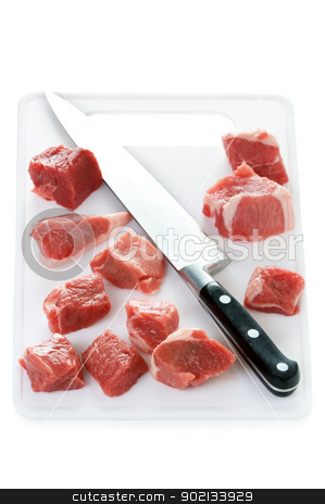 raw cubes lamb on a chopping board stock photo, raw lamb meat cut in cubes isolated on a white background by Lee Avison