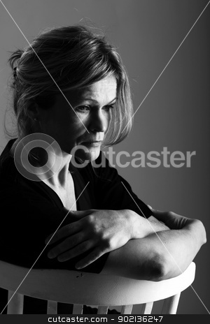 Portrait of beautiful mature on a chair stock photo, Black and white portrait of beautiful mid aged woman on a chair by yekostock
