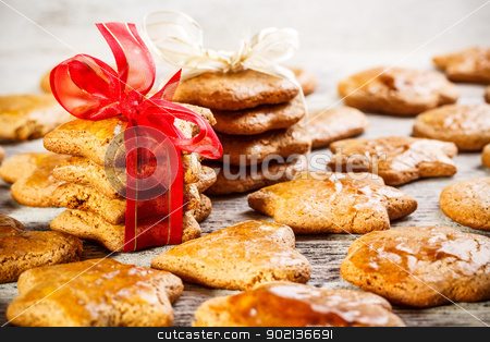 Gingerbread cookies stock photo, Christmas homemade gingerbread cookies tied with red ribbon by Grafvision
